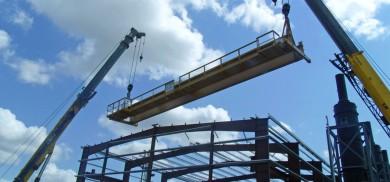 Metal building frame erection using crane
