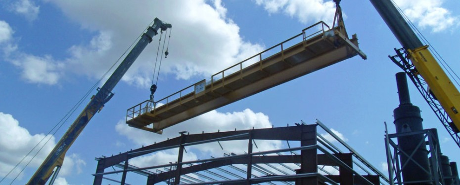 Metal building frame erection using crane